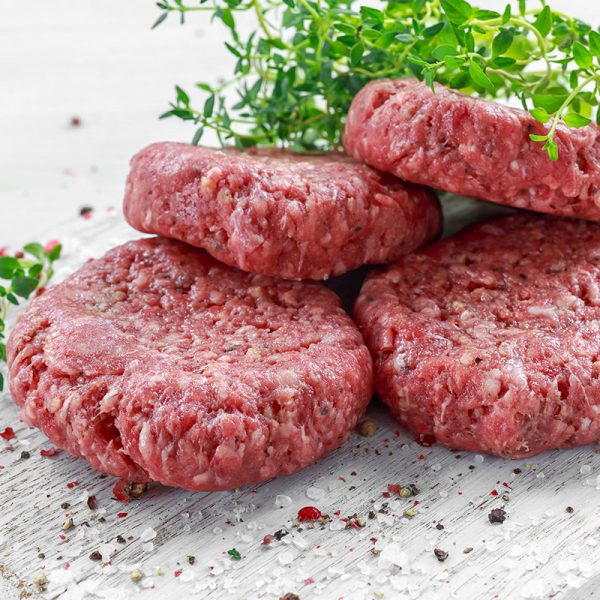 Home HandMade Raw Minced Beef steak burgers on wooden board